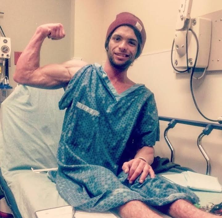 Blake Simpson flexing upon recovery in the hospital.